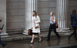 Businesswoman  walking on the street against of Bank of England wall Stock Photo