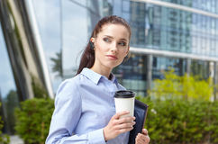 Businesswoman Walking On Street Holding Coffee Royalty Free Stock Photo
