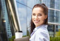 Businesswoman Walking On Street Holding Coffee Royalty Free Stock Photos