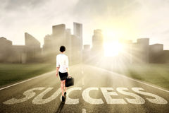 Businesswoman walking on the success way Stock Photo