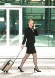 Businesswoman walking and talking in the city Royalty Free Stock Image