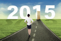 Businesswoman walking to the future. Woman walking on the road towards the future 2015 Stock Images