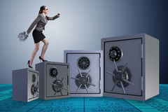 The businesswoman walking on top of safe Royalty Free Stock Image