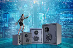 The businesswoman walking on top of safe. Businesswoman walking on top of safe Royalty Free Stock Image