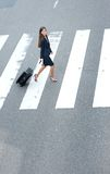 Businesswoman walking with travel bags Royalty Free Stock Photography