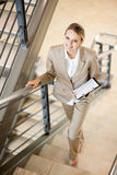 Businesswoman walking up stairs. Gorgeous young businesswoman walking up stairs Stock Photography