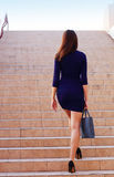 Businesswoman walking up the stairs. To the top Royalty Free Stock Images