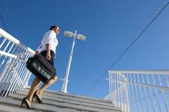 Businesswoman walking upstairs Royalty Free Stock Image