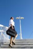 Businesswoman walking upstairs II Royalty Free Stock Image