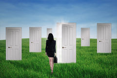 Businesswoman walks into opportunity doors Royalty Free Stock Photos