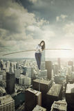 Businesswoman walks with stick over the city Royalty Free Stock Image