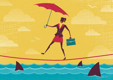 Businesswoman walks Tightrope with Umbrella. Stock Photo