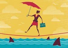 Businesswoman walks Tightrope with Umbrella. Stock Photo