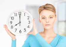 Businesswoman with wall clock Royalty Free Stock Images