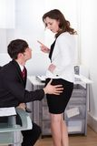 Businesswoman warning colleague while being sexually abused Royalty Free Stock Images