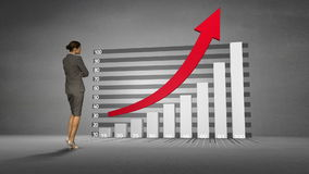Businesswoman watching progress graph with arrow stock video footage