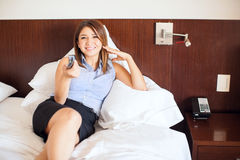 Businesswoman watching TV in a hotel Stock Photography