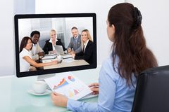 Businesswoman watching video conference Stock Photo