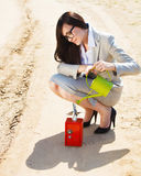 Businesswoman watering a money in safe Stock Photography