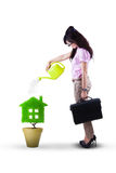 Businesswoman watering plant isolated Royalty Free Stock Photo
