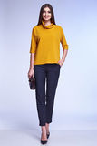 Businesswoman wear yellow silk jacket cotton trousers suit Royalty Free Stock Image