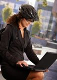Businesswoman wearing bike helmet Stock Photo