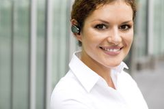 Businesswoman wearing bluetooth Royalty Free Stock Images