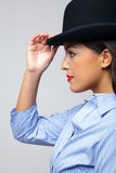 Businesswoman wearing a bowler hat. Royalty Free Stock Photos
