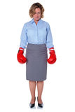Businesswoman wearing boxing gloves Royalty Free Stock Image