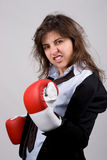 Businesswoman wearing boxing gloves Royalty Free Stock Images