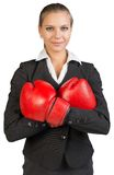 Businesswoman wearing boxing gloves, arms crossed Royalty Free Stock Photos