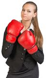 Businesswoman wearing boxing gloves, giving tough Stock Image