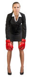 Businesswoman wearing boxing gloves Royalty Free Stock Photo