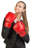 Businesswoman wearing boxing gloves, looking ahead Royalty Free Stock Images