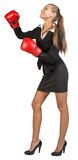 Businesswoman wearing boxing gloves, looking ahead Royalty Free Stock Photo