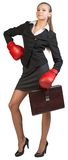 Businesswoman wearing boxing gloves standing Royalty Free Stock Image