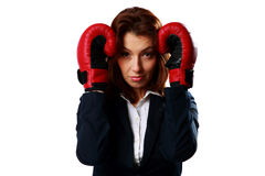 Businesswoman wearing boxing gloves standing in protective pose Stock Photography