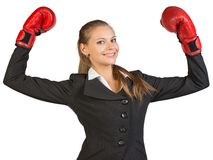 Businesswoman wearing boxing gloves wins Royalty Free Stock Photos