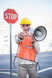 Businesswoman wearing builders clothes pointing at camera Stock Photography