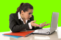 Businesswoman wearing business suit working on laptop computer green chroma key Royalty Free Stock Photos