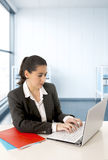 Businesswoman  wearing a business suit working on laptop computer at modern office room Royalty Free Stock Photo