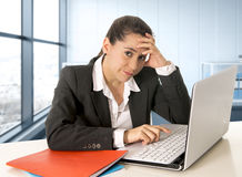 Businesswoman wearing business suit working on laptop computer at modern office room Stock Photo