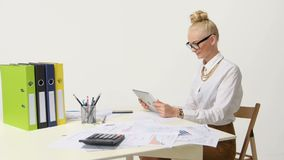 Businesswoman wearing casual shirt sitting at desk stock footage