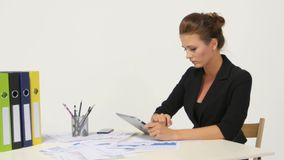 Businesswoman wearing casual shirt sitting at desk stock video