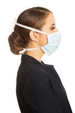 Businesswoman wearing doctor mask Royalty Free Stock Images