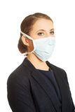 Businesswoman wearing doctor mask Stock Photography