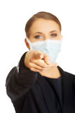 Businesswoman wearing doctor mask Stock Photo