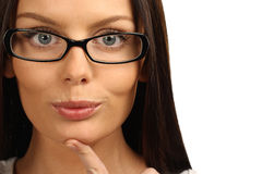 Businesswoman wearing glasses. Close up portrait of a beautiful young businesswoman wearing glasses. Isolated over white background Stock Images