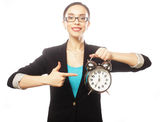 Businesswoman wearing glasses holding alarm clock Royalty Free Stock Image