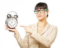 Businesswoman wearing glasses holding alarm clock Stock Image